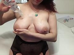 Busty Redhead oils tits