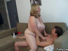 Heavy tits blonde rides him