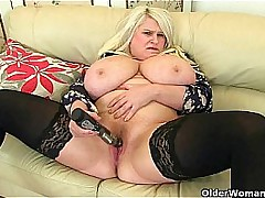 Heavy titted milf Sam fucks herself with a dildo