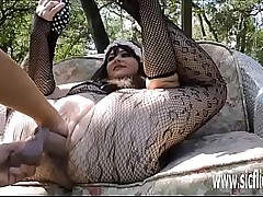 Stuffing her greedy pussy upon a huge fist added to dildo