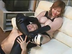 Big-breasted Asian woman sits down on young male`s face and lets him lick her